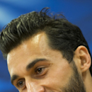 Real Madrid's Alvaro Arbeloa smiles as he answers questions during a press conference at Anfield Stadium, in Liverpool, England, Tuesday, Oct. 21, 2014. Real Madrid will play Liverpool in a Champion's League Group B soccer match on Wednesday