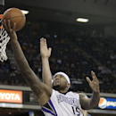Sacramento Kings center DeMarcus Cousins goes to the basket against Minnesota Timberwolves center Nikola Pekovic, of Montenegro, during the third quarter of an NBA basketball game in Sacramento, Calif., Saturday, March 1, 2014. The Timberwolves won 108-9