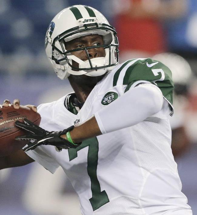 New York Jets quarterback Geno Smith throws a pass as he warms up for the Jets' NFL football game against the New England Patriots on Thursday, Sept. 12, 2013, in Foxborough, Mass