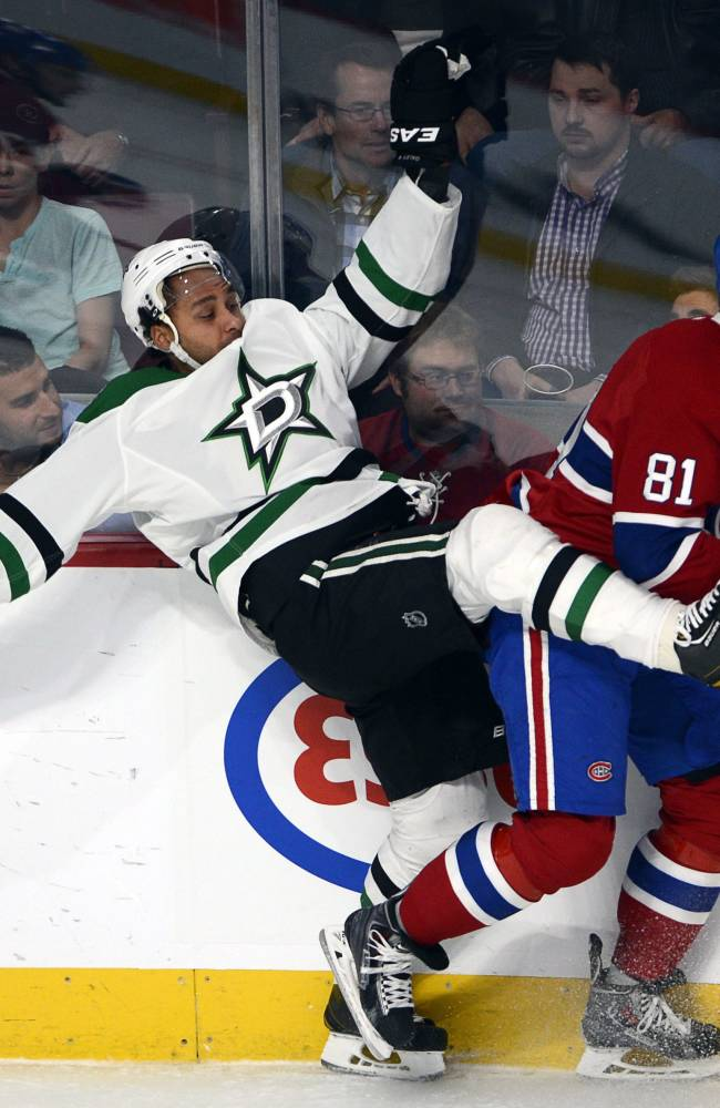 Dallas Stars defenseman Trevor Daley, left, runs into Montreal Canadiens center Lars Eller during the first period of an NHL hockey game Tuesday, Oct. 29, 2013, in Montreal