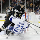 Anaheim Ducks' Bryan Allen, top, checks Tampa Bay Lightning's J.T. Brown during the first period of an NHL hockey game on Friday, Nov. 22, 2013, in Anaheim, Calif The Associated Press