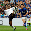 Everton's Sylvain Distin, left, stretches for the ball watched by Leicester's David Nugent during the English Premier League soccer match between Leicester City and Everton at King Power Stadium, in Leicester, England, Saturday, Aug 16, 2014
