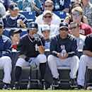 From left to right, New York Yankees Hall-of-Famer and special adviser Reggie Jackson, Yankees' Ichiro Suzuki, Yankees' hitting coach Kevin Long, and Yankees' Derek Jeter watch a spring training baseball game against the Tampa Bay Rays in Tampa, Fla., Sun