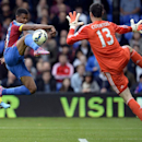Crystal Palace's Fraizer Campbell, left, has a shot at goal whilst challenged by Chelsea's Thibaut Courtois during their English Premier League soccer match at Selhurst Park, London, Saturday, Oct. 18, 2014