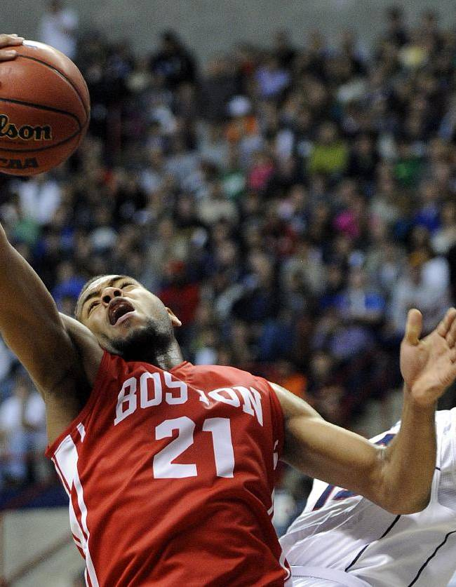 Boston University's Cedric Hankerson (21) fights for a rebound with Connecticut's Shabazz Napier during the first half of an NCAA college basketball game in Storrs, Conn., on Sunday, Nov. 17, 2013