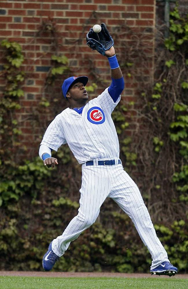 Chicago Cubs left fielder Junior Lake catches a fly ball hit by the Milwaukee Brewers' Scooter Gennett during the first inning of a baseball game on Friday, May 16, 2014, in Chicago