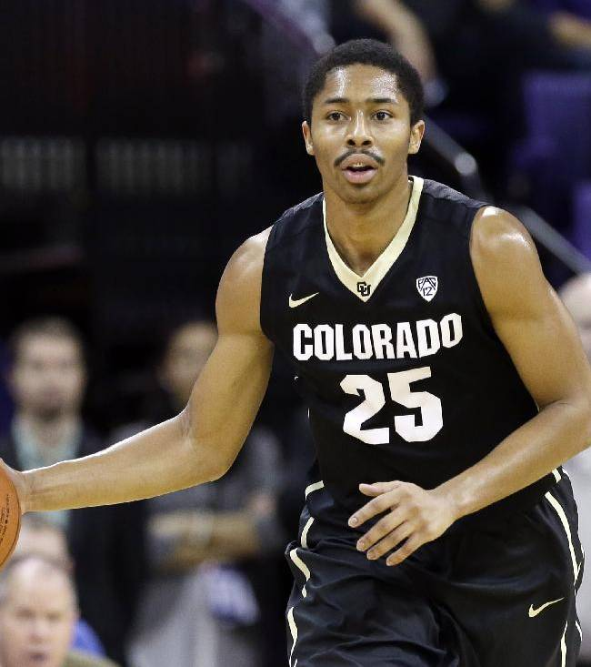 Colorado's Spencer Dinwiddie in action against Washington in the first half of an NCAA men's basketball game Sunday, Jan. 12, 2014, in Seattle