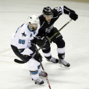 San Jose Sharks' Brent Burns (88) is chased by Los Angeles Kings' Trevor Lewis (22) during the first period of an NHL hockey game Wednesday, Jan. 21, 2015, in San Jose, Calif The Associated Press