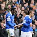Everton's Romelu Lukaku, left, celebrates scoring his team's second goal of the game with teammate Leighton Baines, right, during their English Premier League soccer match against Swansea City at Goodison Park, Liverpool, England, Saturday, March 22, 2014