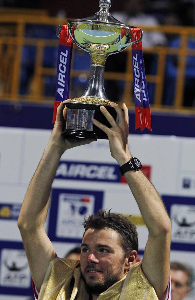 Stanislas Wawrinka of Switzerland lifts the trophy after winning the ATP Chennai Open tennis tournament in Chennai, India, Sunday, Jan. 5, 2014. Wawrinka defeated France's Edouard Roger-Vasselin in the final game