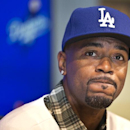 Dodgers newly acquired infielder Jimmy Rollins takes questions from the medias as he is introduced at Dodger Stadium in Los Angeles Wednesday, Jan. 7, 2015. Jimmy Rollins waived his no-trade clause after 14 years in Philadelphia to join the Los Angeles Do
