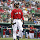 Boston Red Sox's Dustin Pedroia smiles after swinging at and missing a pitch by Northeastern pitcher Dustin Hunt in the first inning of an exhibition baseball game Thursday, Feb. 27, 2014, in Fort Myers, Fla The Associated Press