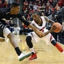 Louisville's Russ Smith, right, attempts to drive around the defense of Providence's Kris Dunn during the second half of an NCAA college basketball game on Wednesday, Jan. 2, 2013, in Louisville, Ky. Louisville defeated Providence 80-62. (AP Photo/Timothy D. Easley)