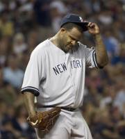 New York Yankees pitcher CC Sabathia, reacts after throwing a pitch in the dirt against the Cleveland Indians, in the sixth inning of a baseball game in Cleveland, Friday, Aug. 24, 2012. (AP Phil Long)