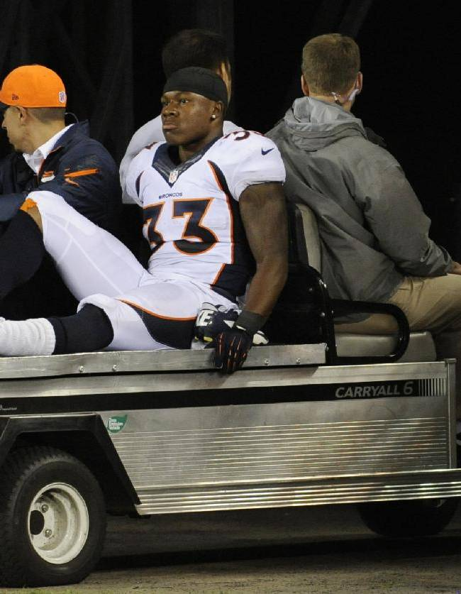 Denver Broncos' Duke Ihenacho (33) is carted off the field after being injured during the second half of an NFL football game against the New York Giants Sunday, Sept. 15, 2013, in East Rutherford, N.J. The Broncos won the game 41-23