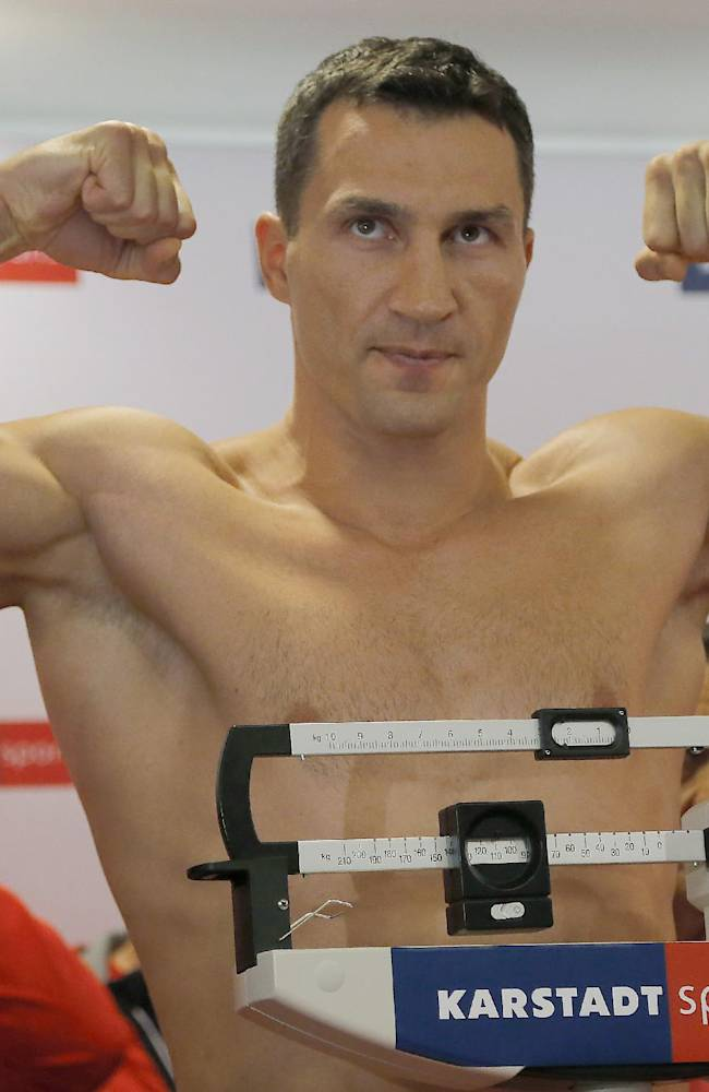 World boxing champion Wladimir Klitschko of Ukraine poses during the weighing procedure ahead of his IBF, IBO, WBO and WBA heavyweight title bout against challenger Alex Leapai from Australia-Samoa, in Muelheim, Germany, Friday, April 25, 2014