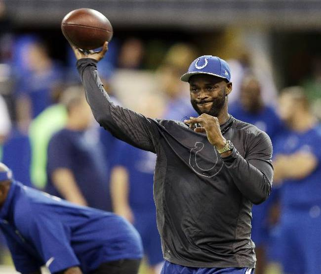 Injured Indianapolis Colts wide receiver Reggie Wayne throws before an NFL football game against the St. Louis Rams in Indianapolis, Sunday, Nov. 10, 2013.  Wayne is out for the season with a torn ACL