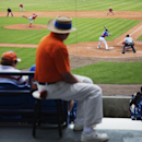 An usher watches as Washington Nationals pitcher Drew Storen throws to New York Mets' Eric Campbell, right, in the eighth inning of an exhibition spring training baseball game, Thursday, March 27, 2014, in Port St. Lucie, Fla The Associated Press