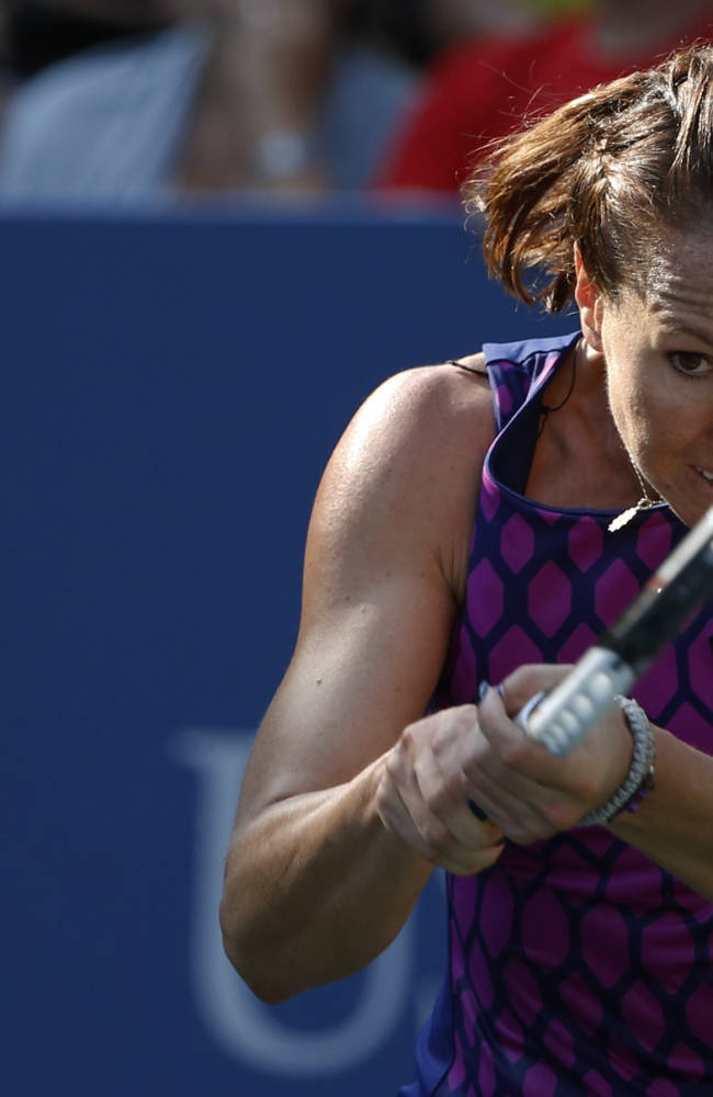 Jelena Jankovic, of Serbia, returns a shot against Tsvetana Pironkova, of Bulgaria, during the second round of the 2014 U.S. Open tennis tournament, Wednesday, Aug. 27, 2014, in New York