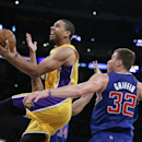 Los Angeles Lakers' Xavier Henry, left, drives to the basket past Los Angeles Clippers' Blake Griffin during the first half of an NBA basketball game on Thursday, March 6, 2014, in Los Angeles The Associated Press