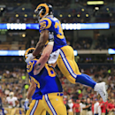 St. Louis Rams running back Benny Cunningham (36) celebrates with center Scott Wells (63) after Cunningham scored a touchdown against the San Francisco 49ers in the first quarter of an NFL football game Monday, Oct. 13, 2014, in St Louis The Associated Pr