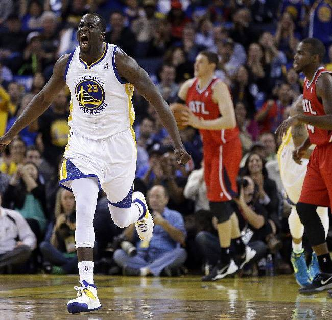 Golden State Warriors' Draymond Green, left, celebrates a score against the Atlanta Hawks during the second half of an NBA basketball game Friday, March 7, 2014, in Oakland, Calif