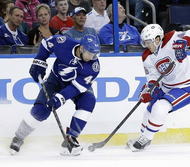 Montreal Canadiens center Daniel Briere (48) strips Tampa Bay Lightning center Nate Thompson (44) of the puck during the first period of Game 1 of a first-round NHL hockey playoff series on Wednesday, April 16, 2014, in Tampa, Fla