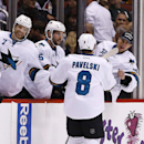 San Jose Sharks' Joe Pavelski (8) celebrates with teammates Brad Stuart (7), Jason Demers (5) and Alex Stalock (32) after his second goal during the first period of an NHL hockey game against the Phoenix Coyotes, Saturday, April 12, 2014, in Glendale, Ari