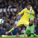 Chelsea's Diego Costa, top, is thwarted by Everton's goalkeeper Tim Howard during their English Premier League soccer match at Goodison Park Stadium, Liverpool, England, Saturday Aug. 30, 2014