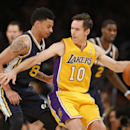 Los Angeles Lakers Steve Nash dribbles the ball as Utah Jazz's Diante Garrett defends during the first half of an NBA basketball game in Los Angeles, Tuesday, Feb. 11, 2014 The Associated Press