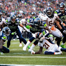 Seattle Seahawks running back Marshawn Lynch, center, dives into the end zone to score a touchdown against the Denver Broncos, Sunday, Sept. 21, 2014, in Seattle The Associated Press