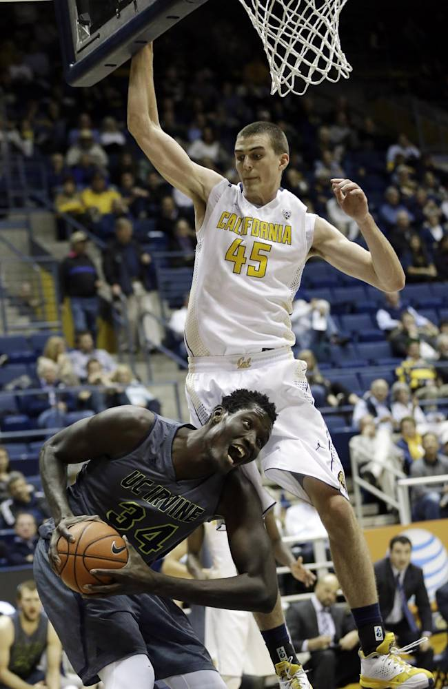 UC Irvine's Mamadou Ndiaye (34) positions himself for a layup next to California 's David Kravish (45) during the second half on an NCAA college basketball game on Monday, Dec. 2, 2013, in Berkeley, Calif
