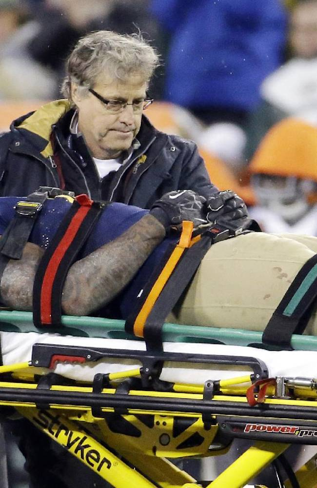 In this Oct. 20, 2013, file photo, Green Bay Packers' Jermichael Finley is taken off the field on a stretcher during the second half of an NFL football game against the Cleveland Browns, in Green Bay, Wis. Finley has tweeted that he left the intensive care unit and had full feeling in his arms and legs after injuring his neck in the game. Finley posted Monday night, Oct. 21, 2013, on Twitter that he was able to walk to and from the shower. He thanked family, friends, teammates and fans for an outpouring of support