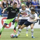 Seattle Sounders' Clint Dempsey, left, battles Tottenham Hotspur's Lewis Holtby, center, and Ryan Mason for the ball during the second half of a friendly soccer match in Seattle, Saturday, July 19, 2014. The match ended in a 3-3 draw
