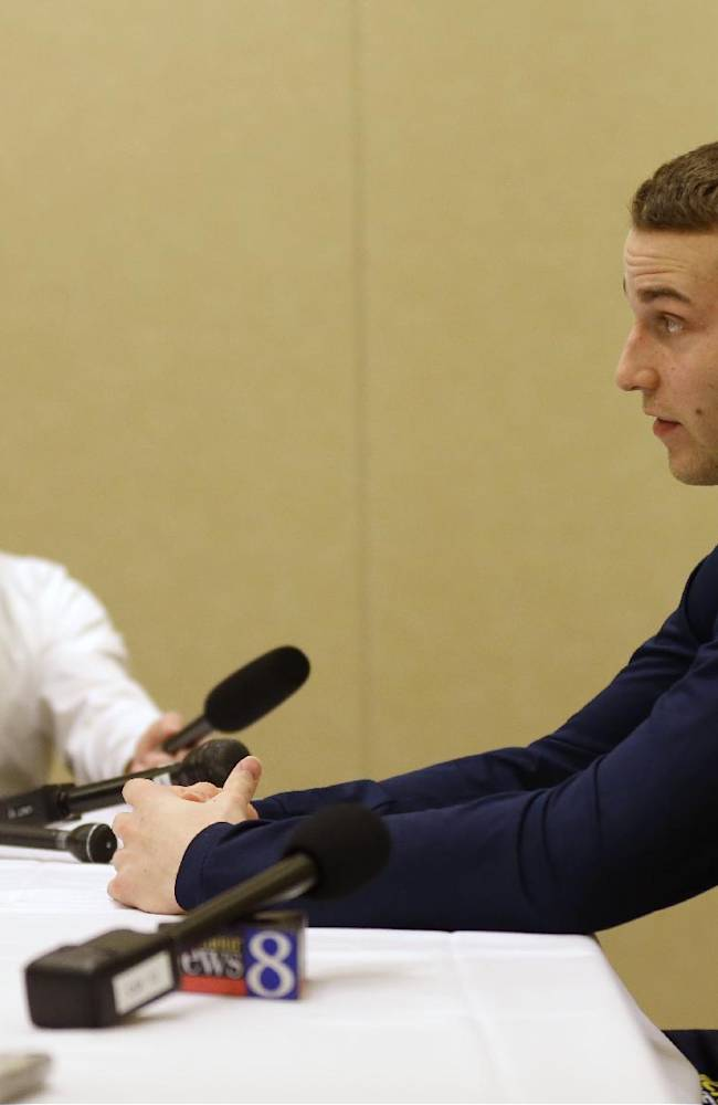 Michigan's Nik Stauskas answers a question during an interview session for the NCAA Midwest Regional final college basketball tournament game Saturday, March 29, 2014, in Indianapolis. Michigan plays Kentucky in the final on Sunday, March 30, 2014