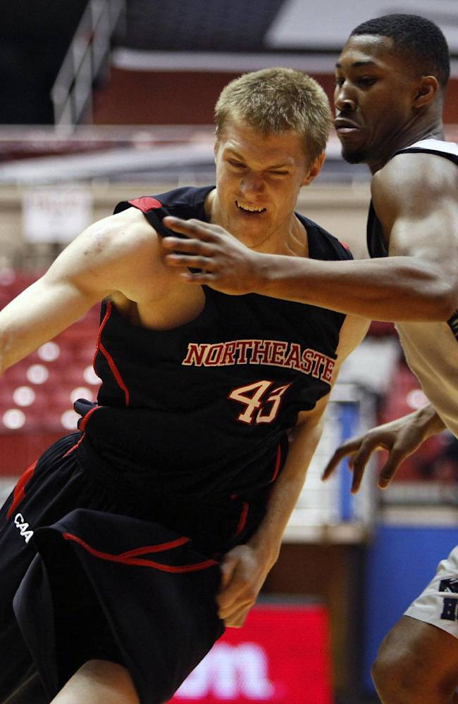 Northeastern forward Scott Eatherton, left, drives the ball against Georgetown's Mikael Hopkins during a NCAA college basketball game in San Juan, Puerto Rico, Thursday, Nov. 21, 2013