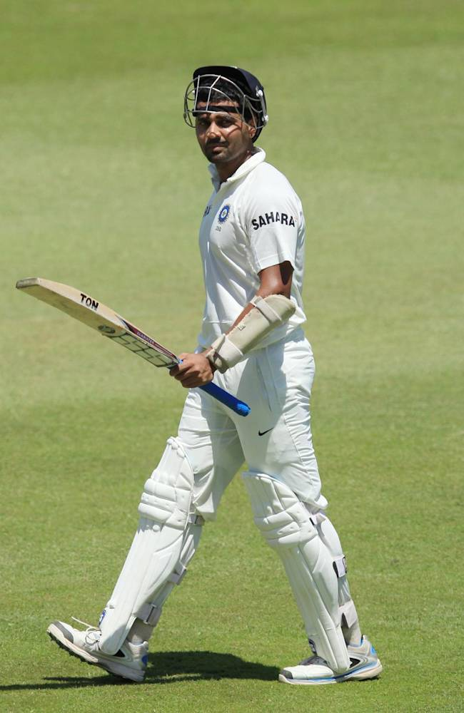 India's batsman Murali Vijay leaves the field after dismissed by South Africa's bowler Dale Steyn, for 97 runs during second day of their cricket test match at Kingsmead stadium, Durban, South Africa, Friday, Dec. 27, 2013