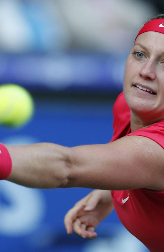 Petra Kvitova of the Czech Republic returns the ball against Venus Williams of the United States during their semi-final match of the Pan Pacific Open tennis tournament in Tokyo, Friday, Sept. 27, 2013