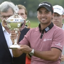 Jason Day holds the winner's trophy at the Canadian Open golf tournament in Oakville, Ontario, Sunday, July 26, 2015. (Paul Chiasson/The Canadian Press via AP) MANDATORY CREDIT