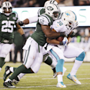 New York Jets inside linebacker David Harris (52) tackles Miami Dolphins running back Daniel Thomas (30) during the second quarter of an NFL football game, Monday, Dec. 1, 2014, in East Rutherford, N.J The Associated Press