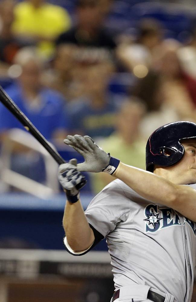 Seattle Mariners' Kyle Seager hits a double during the fourth inning of an interleague baseball game against the Miami Marlins, Friday, April 18, 2014, in Miami