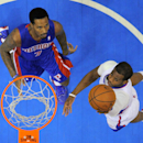 Los Angeles Clippers guard Chris Paul, right, goes up for a shot as Detroit Pistons guard Brandon Jennings defends during the first half of an NBA basketball game, Saturday, March 22, 2014, in Los Angeles The Associated Press