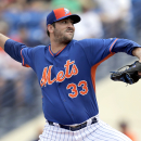 New York Mets starting pitcher Matt Harvey throws during the first inning of an exhibition spring training baseball game against the Detroit Tigers Friday, March 6, 2015, in Port St. Lucie, Fla. (AP Photo/Jeff Roberson)