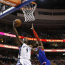 Memphis Grizzlies' Tony Allen, left, goes up for a shot against Philadelphia 76ers' Tony Wroten during the first half of an NBA basketball game, Saturday, March 15, 2014, in Philadelphia. (AP Photo/Matt Slocum)