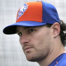 FILE - In this Feb. 26, 2015, file photo, New York Mets' Daniel Murphy pauses while working out in a batting cage during a spring training baseball practice in Port St. Lucie, Fla. Murphy says he disagrees with the