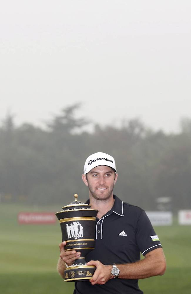 Dustin Johnson of the United States holds his champion trophy during the award ceremony of the HSBC Champions golf tournament at the Sheshan International Golf Club in Shanghai, China, Sunday, Nov. 3, 2013