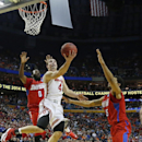 Ohio State's Aaron Craft (4) drives past Dayton's Khari Price (0) and Devin Oliver (5) during the second half of a second-round game in the NCAA college basketball tournament in Buffalo, N.Y., Thursday, March 20, 2014. Dayton won the game 60-59 The Associ
