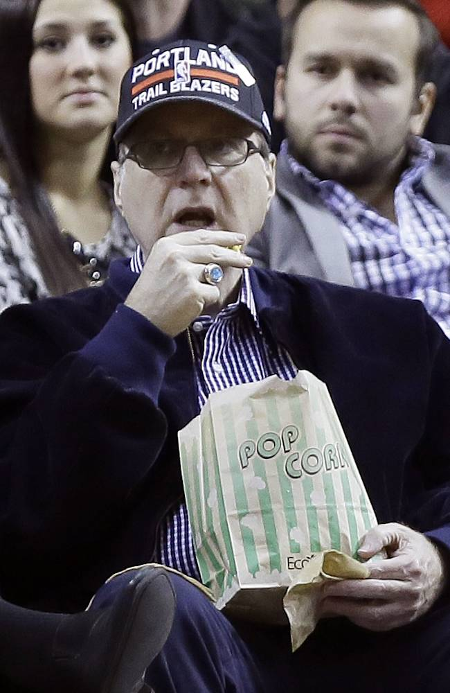 Portland Trail Blazers owner Paul Allen watches from his seat under the basket during the second half of an NBA basketball game against the Denver Nuggets in Portland, Ore., Thursday, Jan. 23, 2014.  Portland Won 110-105