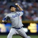 Los Angeles Dodgers starting pitcher Hyun-Jin Ryu (99) works in the first inning of a baseball game against the Atlanta Braves, Friday, May 17, 2013, in Atlanta.  (AP Photo/John Bazemore)