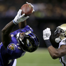 Baltimore Ravens wide receiver Jeremy Butler (17) tries to pull in a pass over New Orleans Saints defensive back Terrence Frederick during the second half of an NFL preseason football game in New Orleans, Thursday, Aug. 28, 2014 The Associated Press